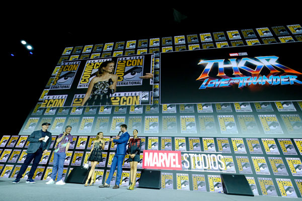 SAN DIEGO, CALIFORNIA - JULY 20: (L-R) President of Marvel Studios Kevin Feige, Director Taika Waititi, Natalie Portman, Chris Hemsworth and Tessa Thompson of Marvel Studios' 'Thor: Love and Thunder' at the San Diego Comic-Con International 2019 Marvel Studios Panel in Hall H on July 20, 2019 in San Diego, California.