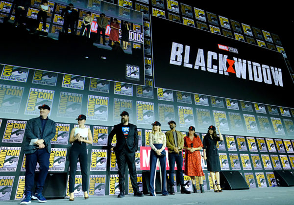 SAN DIEGO, CALIFORNIA - JULY 20: (L-R) President of Marvel Studios Kevin Feige, Scarlett Johansson, David Harbour, Florence Pugh, O-T Fagbenle, Director Cate Shortland and Rachel Weisz of Marvel Studios' 'Black Widow' at the San Diego Comic-Con International 2019 Marvel Studios Panel in Hall H on July 20, 2019 in San Diego, California.