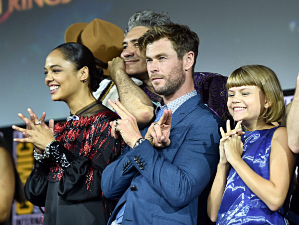 SAN DIEGO, CALIFORNIA - JULY 20: (L-R) Tessa Thompson, Taika Waititi, Chris Hemsworth and Lia McHugh at the San Diego Comic-Con International 2019 Marvel Studios Panel in Hall H on July 20, 2019 in San Diego, California.