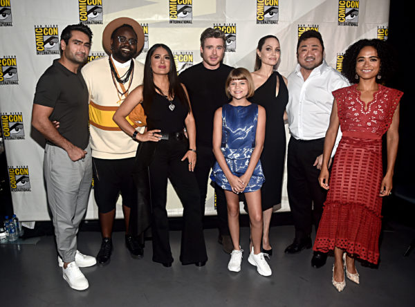 SAN DIEGO, CALIFORNIA - JULY 20: (L-R) Kumail Nanjiani, Brian Tyree Henry, Salma Hayek, Richard Madden, Lia McHugh, Angelina Jolie, Don Lee and Lauren Ridloff of Marvel Studios' 'The Eternals' at the San Diego Comic-Con International 2019 Marvel Studios Panel in Hall H on July 20, 2019 in San Diego, California.